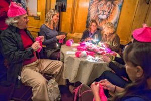 "Peter Sargent, of Gardener, Esther Moerth, Kathleen Leonard, Patti Scutari, Mary Thomas, Donna Horn and Linn McConarty, all of Wendell, knit pink ""Pussy Hats"" at Deja Brew in Wendell, as part of an effort to make hats for attendees of Women's Marches in Boston, Washington and New York City, Wednesday, January 18, 2017. The knitting group has made 46 hats so far."