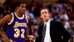NEW YORK - 1990: Magic Johnson #32 of the Los Angeles Lakers talks with head coach Pat Riley during a game against the New York Knicks, circa 1990 at Madison Square Garden in New York, New York. NOTE TO USER: User expressly acknowledges that, by downloading and or using this photograph, User is consenting to the terms and conditions of the Getty Images License agreement. Mandatory Copyright Notice: Copyright 1990 NBAE (Photo by Nathaniel S. Butler/NBAE via Getty Images)